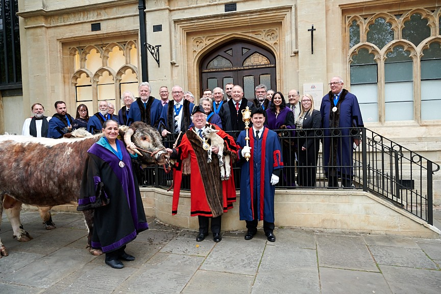 Group photo of councillors and new town mayor with bull and lamb